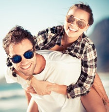 image of man and woman wearing sunglasses